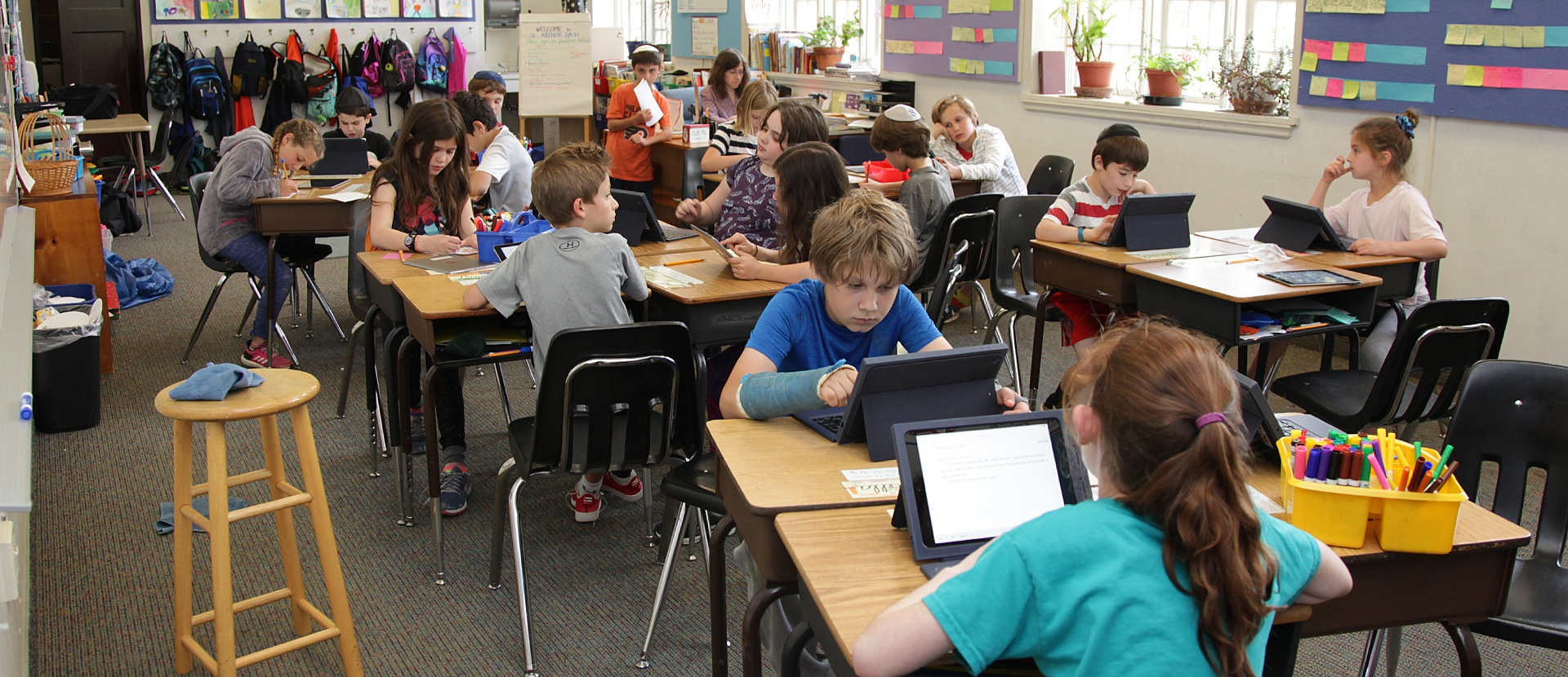 Perelman classroom filled with students each using iPad tablets
